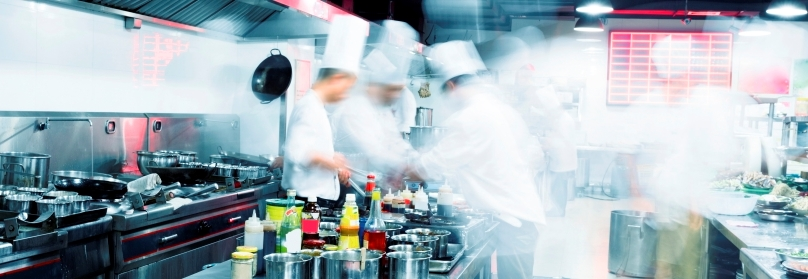 Chefs working in a commercial kitchen