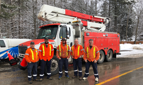 Utilities Kingston crew members in line at the Canada-US border. From left to right, Allan Hawley, William Beattie, Kyle Barrett, Sheldon Waterman, and Chris Mills.