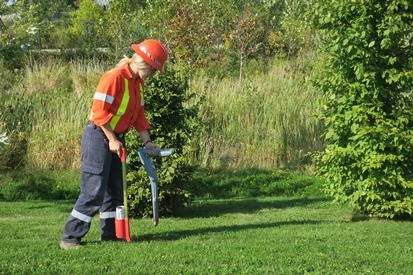 A Utilities Kingston locator using equipment