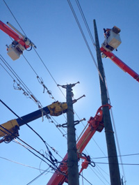 Crews installing anew 60 foot pole