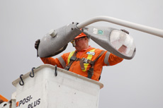 UK technician installing LED street light